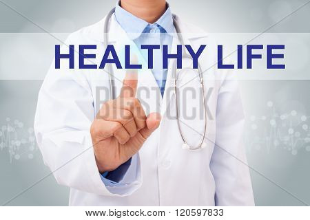 Doctor hand touching healthy life sign on virtual screen.