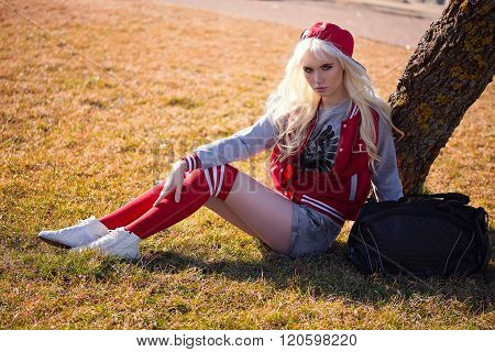 Blonde Young Woman In Posing Outdoors