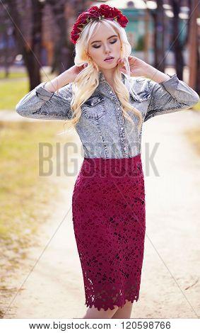 Lovely Blonde Girl In Posing Outdoors