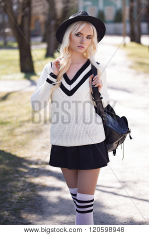 Portrait Of Blonde Young Model Outdoors