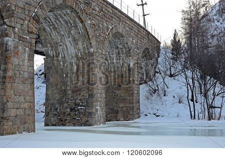 One of the viaducts of Circum-Baikal Railway in winter evening