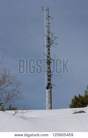 Antenna Pole In The Alps Standing In The Snow