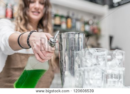 Bar Lady Preparing Cocktails And Pouring Alcohol Into The Glasses