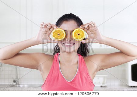 Model Closes Eyes With Pieces Of Orange