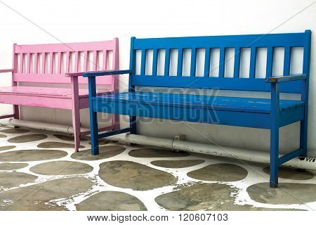 The Blue Wooden Chair Against The Wall. Chairs Placed Over The Pipe