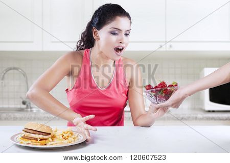 Woman Chooses Strawberry And Refuse Burger