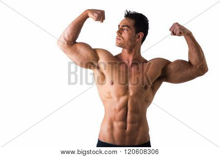 Handsome bodybuilder doing classic double biceps pose