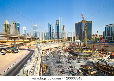 DUBAI - OCTOBER 15: construction activity in Dubai downtown on October 15, 2014 in Dubai, UAE. Dubai is the most populous city and emirate in the United Arab Emirates