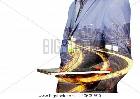 Double Exposure Of A Businessman And A City Using A Tablet