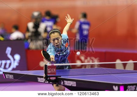 KUALA LUMPUR, MALAYSIA - MARCH 01, 2016: Li Xiaoxia of China plays return shot in her match in the Perfect 2016 World Team Table-tennis Championships held in Kuala Lumpur, Malaysia.