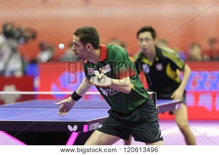 KUALA LUMPUR, MALAYSIA - MARCH 01, 2016: Marcos Freitas of Portugal serves the ball in his match in the Perfect 2016 World Team Table-tennis Championships held in Kuala Lumpur, Malaysia.