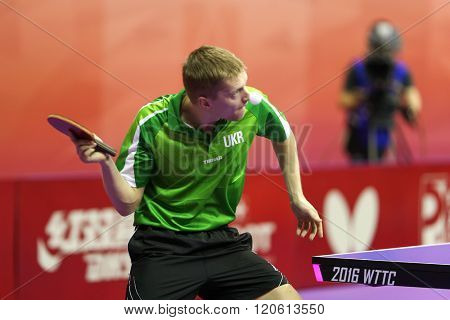KUALA LUMPUR, MALAYSIA - MARCH 01, 2016: Yevhen Pryshchepa of Ukraine plays return shot in his match in the Perfect 2016 World Team Table-tennis Championships held in Kuala Lumpur, Malaysia.
