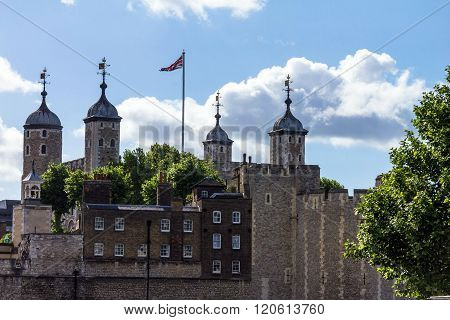 Tower of London historic castle on the north bank of the River Thames in central London - a popular tourist attraction. View of Tower from outside walls.