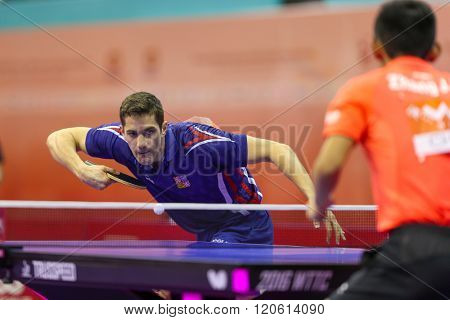 KUALA LUMPUR, MALAYSIA - MARCH 01, 2016: Lubomir Jancarik of the Czech Republic serves the ball in his match in the Perfect 2016 World Team Table-tennis Championships held in Kuala Lumpur, Malaysia.