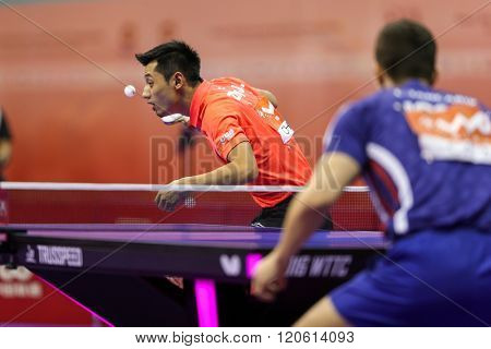 KUALA LUMPUR, MALAYSIA - MARCH 01, 2016: Zhang Jike of China serves the ball in his match in the Perfect 2016 World Team Table-tennis Championships held in Kuala Lumpur, Malaysia.