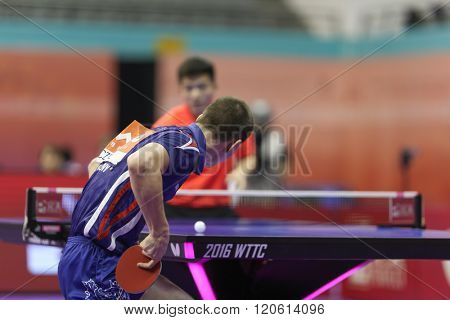 KUALA LUMPUR, MALAYSIA - MARCH 01, 2016: Tomas Konecny of the Czech Republic plays return shot in his match in the Perfect 2016 World Team Table-tennis Championships held in Kuala Lumpur, Malaysia.