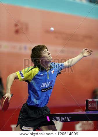 KUALA LUMPUR, MALAYSIA - MARCH 01, 2016: Kenta Matsudiara of Japan tosses the ball to serve in his match in the Perfect 2016 World Team Table-tennis Championships held in Kuala Lumpur, Malaysia.