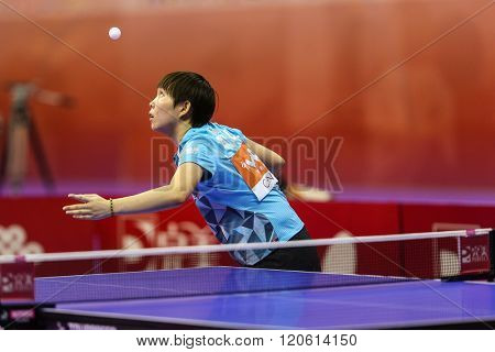 KUALA LUMPUR, MALAYSIA - MARCH 01, 2016: Zhu Yuling of China tosses the ball to serve in her match in the Perfect 2016 World Team Table-tennis Championships held in Kuala Lumpur, Malaysia.