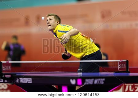 KUALA LUMPUR, MALAYSIA - MARCH 01, 2016: Mattias Karlsson of Sweden serves the ball in his match in the Perfect 2016 World Team Table-tennis Championships held in Kuala Lumpur, Malaysia.