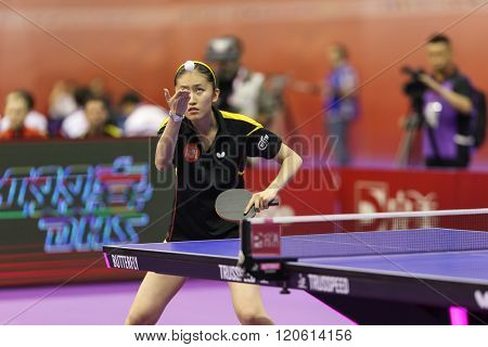 KUALA LUMPUR, MALAYSIA - MARCH 01, 2016: Zhang Xuan of Spain tosses to serveplays a return shot in her match in the Perfect 2016 World Team Table-tennis Championships held in Kuala Lumpur, Malaysia.