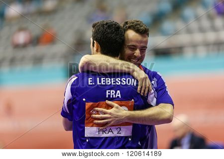 KUALA LUMPUR, MALAYSIA - MARCH 01, 2016: Emmanuel Lebesson of France gets a hug from his teammate after his win in the Perfect 2016 World Team Table-tennis Championships in Kuala Lumpur, Malaysia.