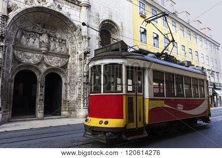 LISBON, LISBON, PORTUGAL - DECEMBER 10, 2015:  Remodelado tram near the Church of Nossa Senhora da Conceicao in Lisbon in Portugal