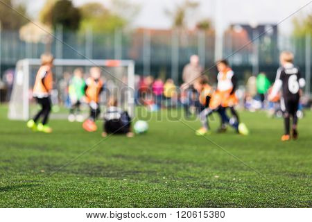 Blurred Young Kids Playing Football