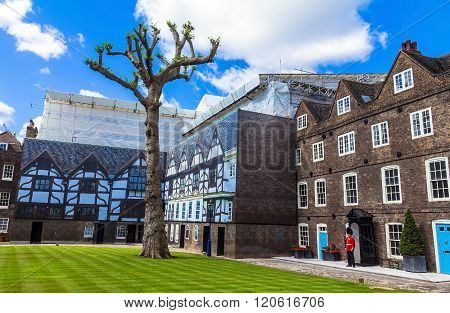 LONDON UK - JUNE 6 2015 :Royal guard near Historic buildings at Tower of London historic castle on the north bank of the River Thames in central London - a popular tourist attraction