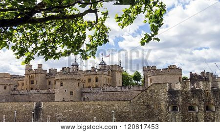 Her Majesty's Royal Palace and Fortress Tower of London historic castle on the north bank of the River Thames in central London - a popular tourist attraction.