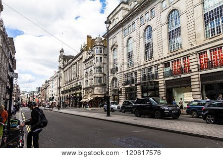 LONDON UK - JUNE 6 2015: Unidentified people and traffic in Piccadilly street . The city is visited by more than 30 million people every year.