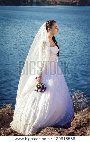 Bride standing on the cliff