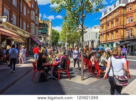 Unidentified Tourists And Locals At South Kensington Area At Summer Day Near  Casa Brindisa Restaura