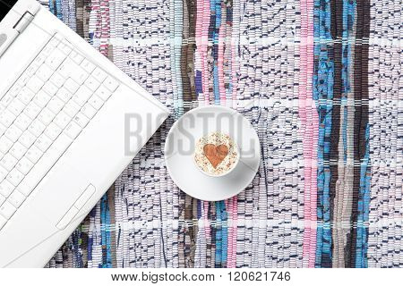 Cup And Laptop Lying On The Table