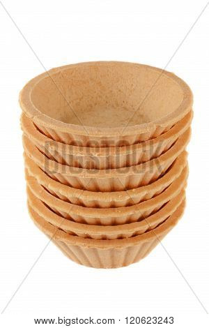A Stack Of Empty Tartlets