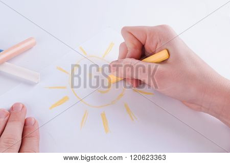 Child Hands Painting A Happy Sun