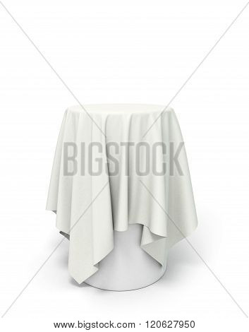 Round White Tablecloth On The Pedestal Isolated On White