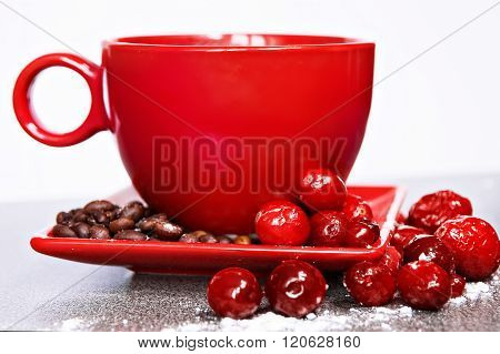 Red Cup On A Saucer With Cowberries