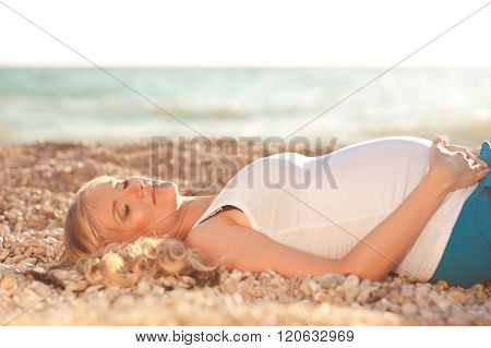 Pregnant woman at seashore