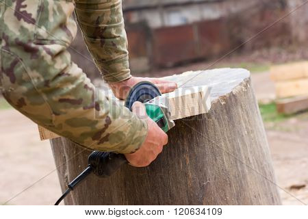 white guy handles grinder wooden detail