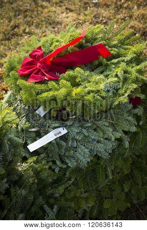 SUCCASUNNA, NJ-DEC 12, 2015: Stack of wreaths to be laid on veterans graves in the combined cemeteries of the First Presbyterian and the United Methodist Church the 2015 Wreaths Across America event.