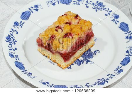 Sweet homemade plum cake on a plate