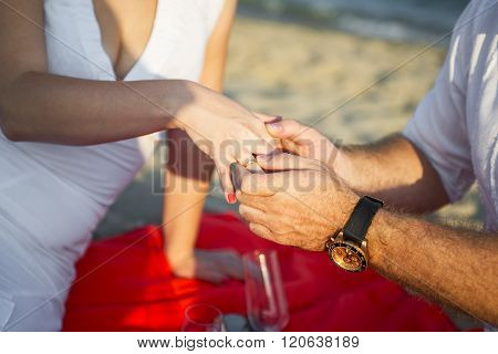 Marriage Proposal at sunset tropical beach