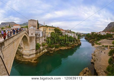 MOSTAR, BOSNIA AND HERZEGOVINA - SEPTEMBER 05: People walking on Old Bridge on September 05, 2015 in Mostar, Bosnia and Herzegovina.