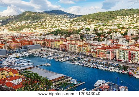 Nice, France - March 3, 2016: Panoramic view of coastline and beach with blue sky luxury resort and bay with yachts Nice port Villefranche-sur-Mer Nice Cote d'Azur French Riviera.