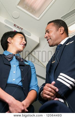 Flight attendant looking at pilot