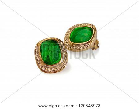 Pair Of Stud Earrings Isolated Over White.