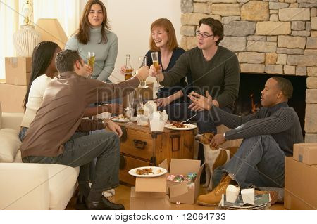 Group of friends toasting over take out food
