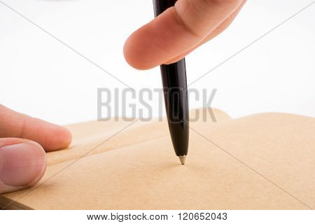 Hand writing on a notebook with a pen