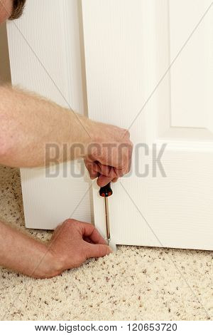 Male Hands Screwing In A Door Guide