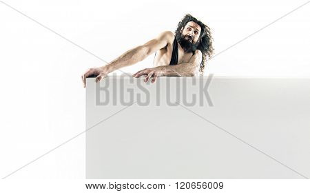 Funny nerd holding an empty board isolated on white background